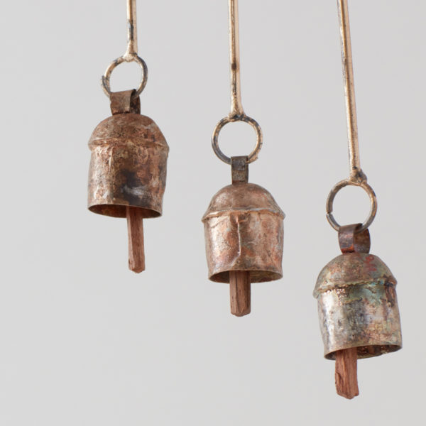 close up of 3 recycled steel chimes