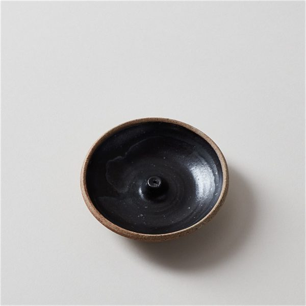 Rustic and hand-thrown pottery incense holder