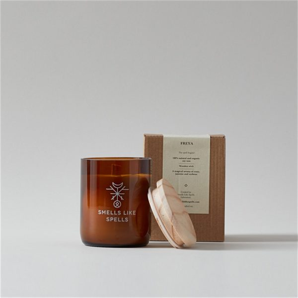 Freya Smells Like Spells Scented Candle with wood lid off in front of package