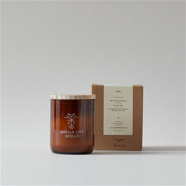 Hag Smells Like Spells Scented Candle with wood lid in front of package