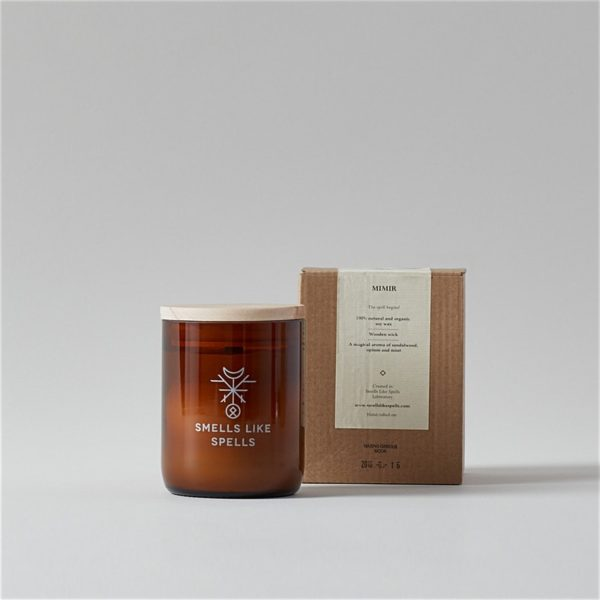 Mimir Smells Like Spells Scented Candle with wood lid in front of package