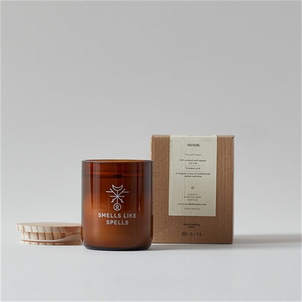 Mimar Smells Like Spells Scented Candle with wood lid off in front of package