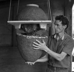 Michael Joshin Thiele holding beehive without protective gear.