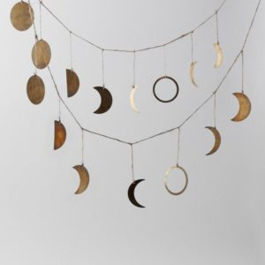 all the phases of the moon in brass strung on jute twine