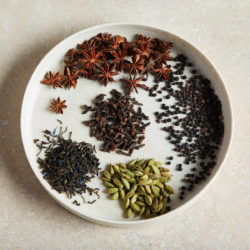 plate of whole spices used to make chai