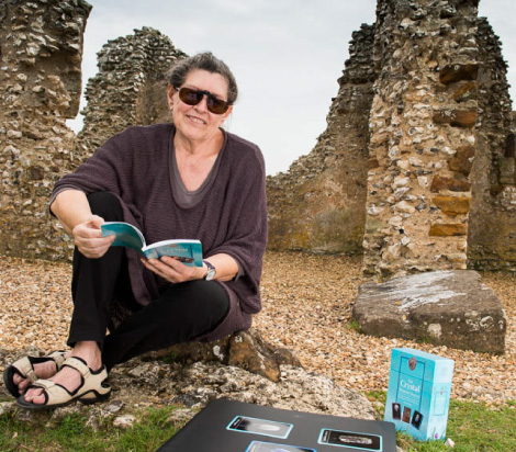 Judy Hall with her book Crystals for Releasing and Healing