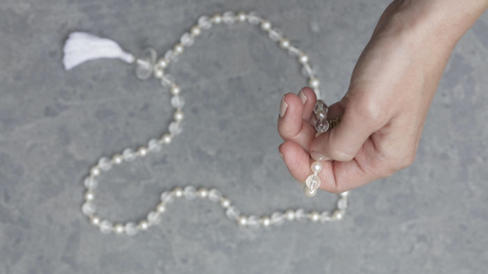 hand holding mala beads