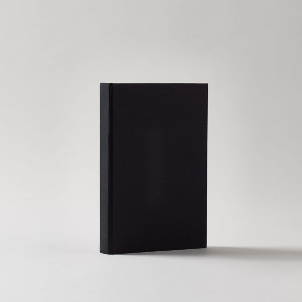 A black linen-covered hardcover journal