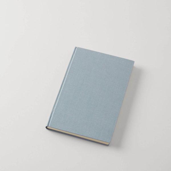 A light blue linen-covered hardcover journal