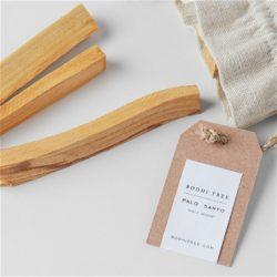 three palo santo sticks outside of bag with tag
