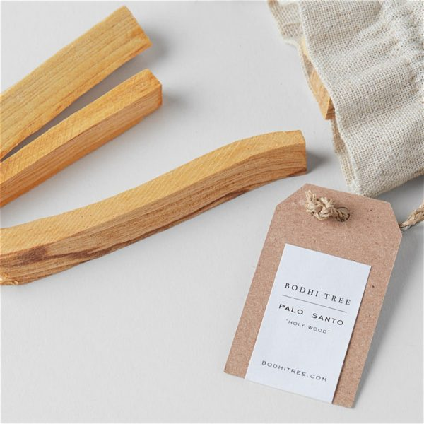 opened linen pouch with 3 palo santo sticks and a label