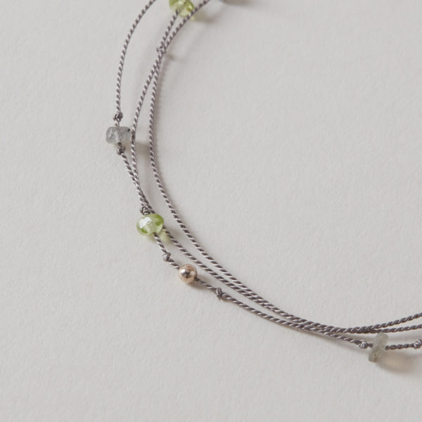 close up silk bracelet with peridot and labradorite