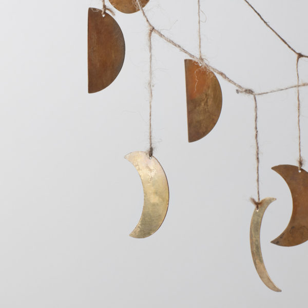 hanging phases of the moon in brass strung on jute twine
