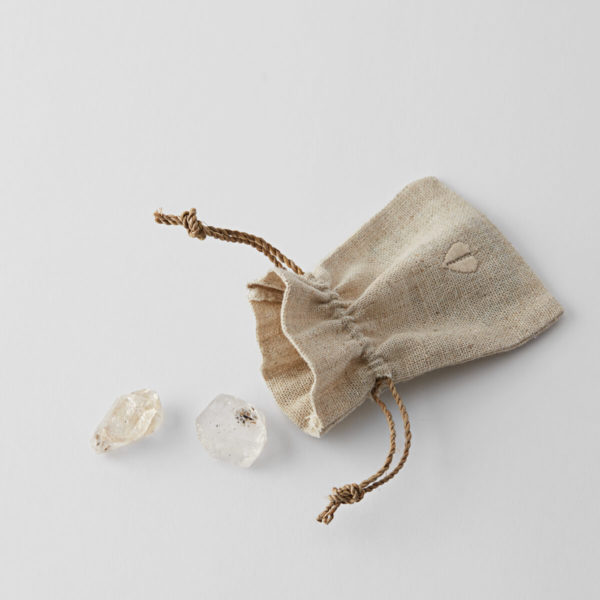 opened linen pouch with two Herkimer diamonds