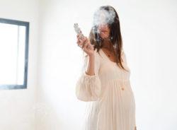 woman saging a room