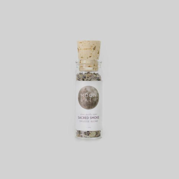 bottle of Moon Bath Sacred Smoke Smudge Blend with cork